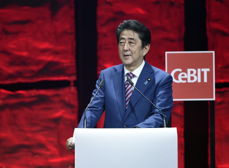 Japanese Prime Minister Shinzo Abe speaks during the opening ceremony of the CeBit computer fair, which will open its doors to the public on March 20, at the fairground in Hanover, Germany, March 19, 2017.     REUTERS/Fabian Bimmer