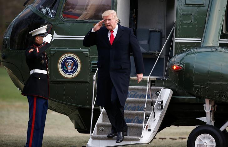 U.S. President Donald Trump salutes as he walks from Marine One upon his return to the White House in Washington, U.S., March 19, 2017.  REUTERS/Joshua Roberts