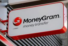FILE PHOTO -  A Moneygram logo is seen outside a bank in Vienna, Austria, June 28, 2016. REUTERS/Heinz-Peter Bader/File Photo