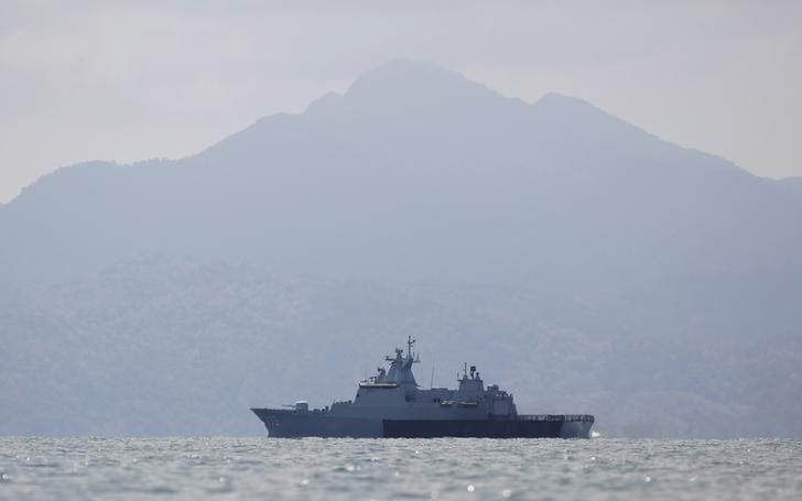 A Malaysian navy vessel patrols waters near Langkawi island, May 17, 2015.  REUTERS/Olivia Harris