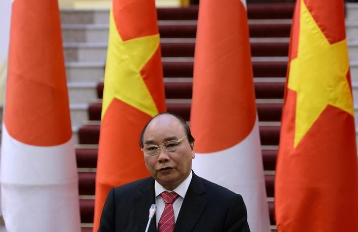 Nguyen Xuan Phuc speaks during a joint press briefing with his Japanese counterpart Shinzo Abe at  Phuc's Cabinet Office in Hanoi, Vietnam January 16, 2017. REUTERS/Hoang Dinh Nam/Pool/Files