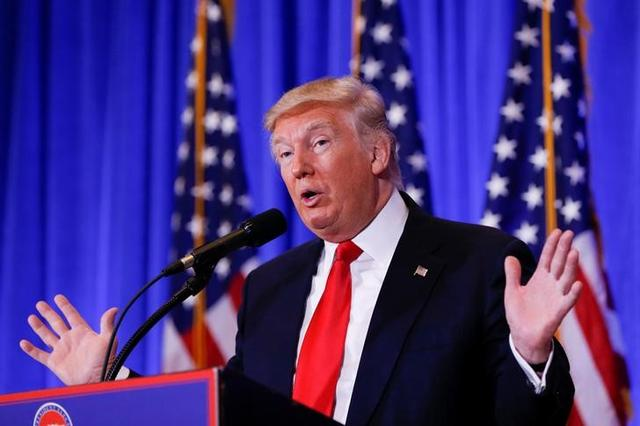 FILE PHOTO: U.S. President Donald Trump speaks during a press conference in Trump Tower, Manhattan, New York, U.S., January 11, 2017. REUTERS/Shannon Stapleton