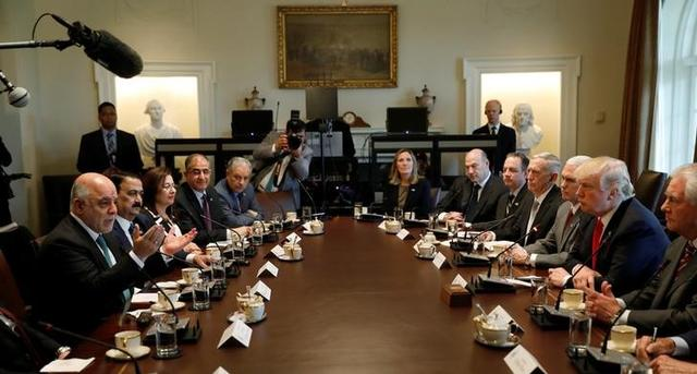 U.S. President Donald Trump meets with Iraqi Prime Minister Haider al-Abadi in the Cabinet Room of the White House in Washington, U.S., March 20, 2017.   REUTERS/Kevin Lamarque
