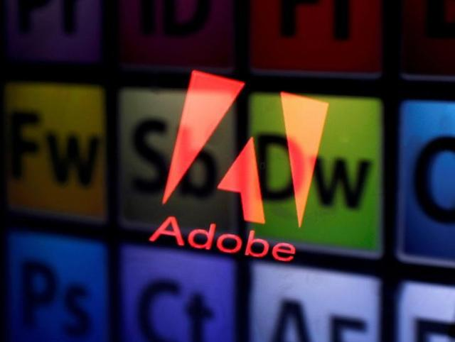 An Adobe logo and Adobe products are seen reflected on a monitor display and an iPad screen, in this picture illustration July 8, 2013.     REUTERS/Dado Ruvic/Illustration/Files