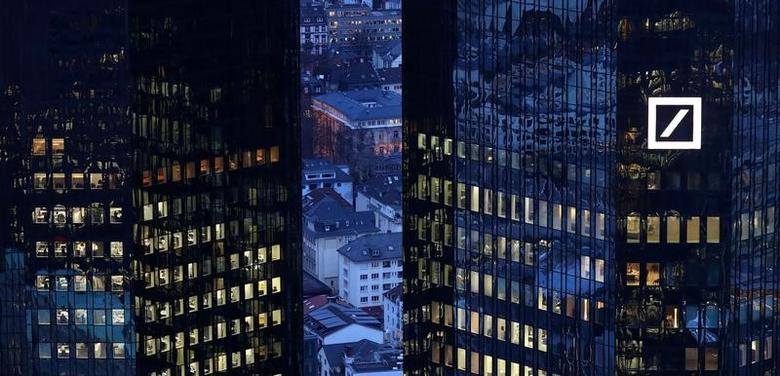 FILE PHOTO: The headquarters of Germany's Deutsche Bank are seen early evening in Frankfurt, Germany January 31, 2017. REUTERS/Kai Pfaffenbach/File Photo          GLOBAL BUSINESS WEEK AHEAD PACKAGE Ð SEARCH BUSINESS WEEK AHEAD MARCH 13 FOR ALL IMAGES