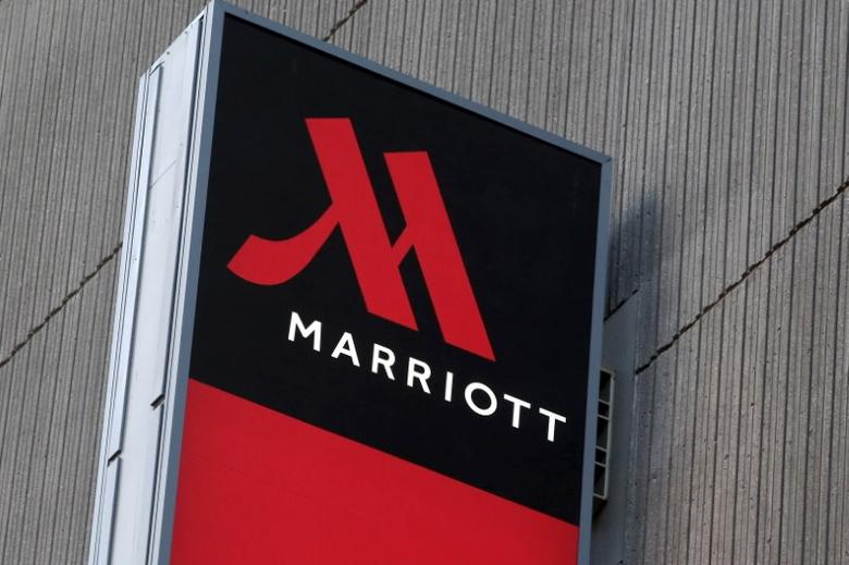Signage for the New York Marriott Marquis is seen in Manhattan, New York, November 16, 2015. REUTERS/Andrew Kelly