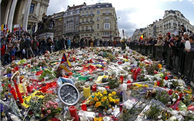 People take part in a rally called ''The march against the fear, Tous Ensemble, Samen Een, All Together'' in memory for the victims of bomb attacks in Brussels metro and Brussels international airport of Zaventem, in Brussels, Belgium, April 17, 2016. REUTERS/Yves Herman/Files