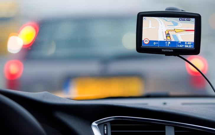 A TomTom navigation device is seen in this photo illustration taken in Amsterdam February 28, 2012. REUTERS/Robin van Lonkhuysen/United Photos/Files