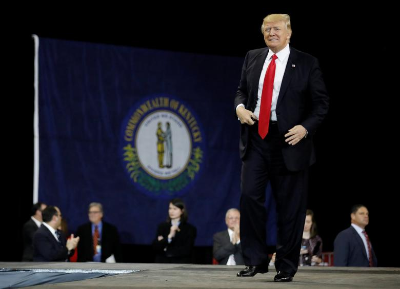 FILE PHOTO: U.S. President Donald Trump takes the stage for a rally at the Kentucky Exposition Center in Louisville, Kentucky, U.S. March 20, 2017. REUTERS/Jonathan Ernst