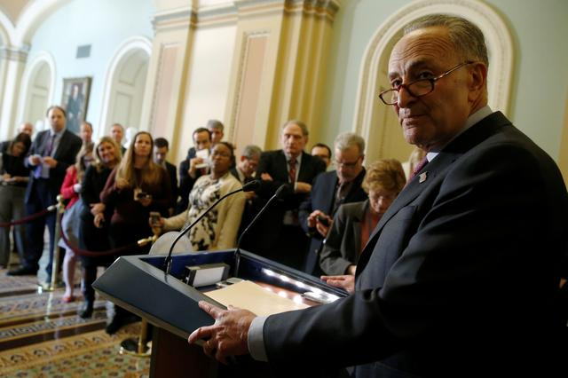 U.S. Senate Minority Leader Chuck Schumer (D-NY) takes a question as he speaks to reporters after the weekly Democratic caucus policy luncheon at the U.S. Capitol in Washington, U.S. March 21, 2017.  REUTERS/Jonathan Ernst