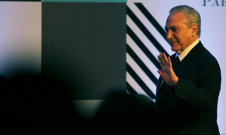 Brazil's President Michel Temer waves to the crowd during the American Chamber of Commerce (AMCHAM) meeting in Sao Paulo, Brazil, March 20, 2017. REUTERS/Paulo Whitaker/Files