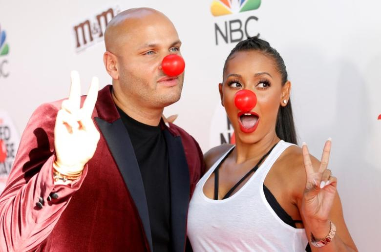 Mel B and her husband Stephen Belafonte pose as they arrive for ''The Red Nose Day Special'' fundraiser in Studio City, U.S., May 26, 2016.   REUTERS/Mario Anzuoni/File Photo