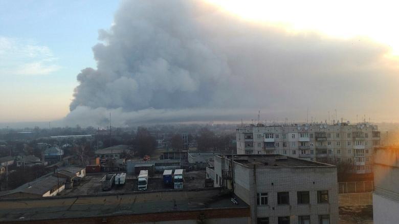 Smoke rises over a warehouse storing tank ammunition at a military base in the town of Balaklia (Balakleya), Kharkiv region, Ukraine, March 23, 2017. State Emergency Service of Ukraine/Handout via REUTERS