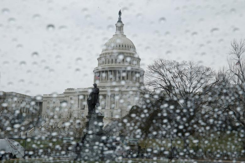 The U.S. Capitol building is seen in the rain as the House of Representatives prepare for a planned vote on the American Health Care Act. REUTERS/Jim Bourg
