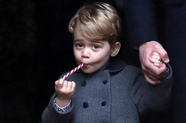 Prince George, the son of the Duke and Duchess of Cambridge, sucks a sweet as he leaves following the morning Christmas Day service at St Mark's Church in Englefield, near Bucklebury in southern England, Britain, December 25, 2016. REUTERS/Andrew Matthews/Pool/files