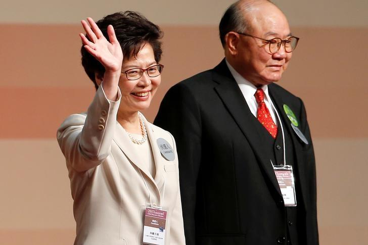 Carrie Lam waves after she won the election for Hong Kong's next Chief Executive as Woo Kwok-hing stands next to her in Hong Kong, China March 26, 2017.   REUTERS/Tyrone Siu