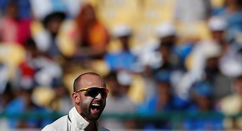 Cricket - India v Australia - Fourth Test cricket match - Himachal Pradesh Cricket Association Stadium, Dharamsala, India - 26/03/17 - Australia's Nathan Lyon celebrates after dismissing India's captain Ajinkya Rahane. REUTERS/Adnan Abidi