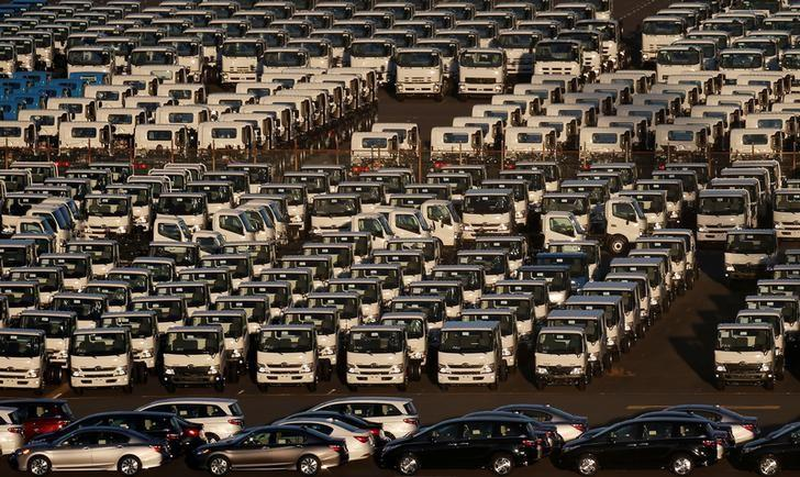 Newly manufactured cars and trucks await export at port in Yokohama, Japan, January 16, 2017. REUTERS/Toru Hanai/File Photo