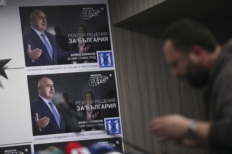 A pre-election poster of the former Bulgarian prime minister and leader of centre-right GERB party Boiko Borisov is seen before a news conference at the party's headquarters in Sofia, Bulgaria March 26, 2017.  REUTERS/Stoyan Nenov