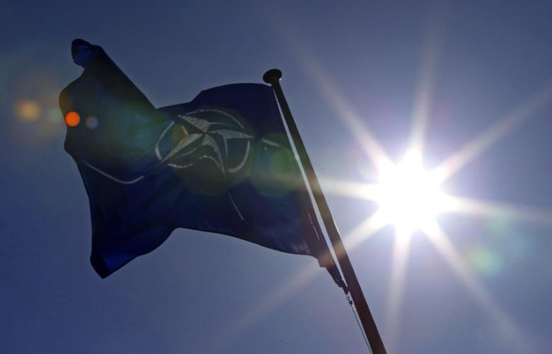 A NATO flag flies at the Alliance headquarters in Brussels during a NATO ambassadors meeting on the situation in Ukraine and the Crimea region, March 2, 2014.  REUTERS/Yves Herman