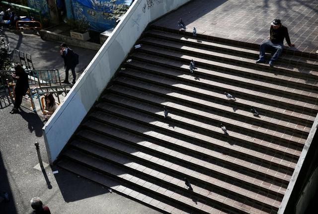 Homeless Makoto Shinbo sits on a stair nearby his makeshift house in Miyashita park in Tokyo, Japan, February 17, 2017. REUTERS/Kim Kyung-Hoon