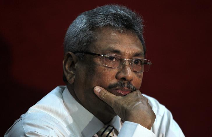 Sri Lanka's former defence secretary Gotabaya Rajapaksa listens during a news conference in Colombo January 24, 2013. REUTERS/Dinuka Liyanawatte