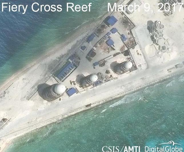 Construction is shown on Fiery Cross Reef, in the Spratly Islands, the disputed South China Sea in this March 9, 2017 satellite image released by CSIS Asia Maritime Transparency Initiative at the Center for Strategic and International Studies (CSIS) to Reuters on March 27, 2017. MANDATORY CREDIT: CSIS/AMTI DigitalGlobe/Handout via REUTERS