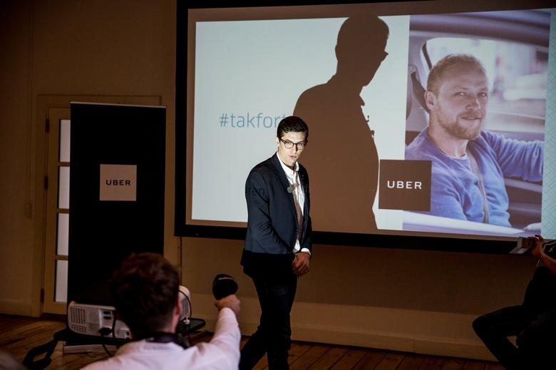 Uber Denmark's spokesperson Kristian Agerbo is seen during a news conference to announce Uber's end of service in Denmark due to a taxi law that sets out new requirements for drivers such as mandatory fare meters, in Copengagen, Denmark March 28, 2017.  Scanpix Denmark/Nikolai Linares/via Reuters