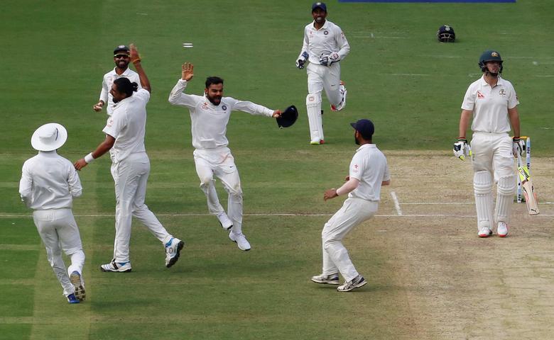 India v Australia - Second Test cricket match - M Chinnaswamy Stadium, Bengaluru, India - 05/03/17. India's captain Virat Kohli (C) celebrates the wicket of Australia's Mitchell Marsh with team mates. REUTERS/Danish Siddiqui
