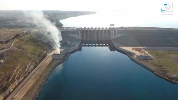 A still image taken from a video posted to a social media website by the Islamic State-affiliated Amaq News Agency on March 27, 2017, shows an aerial view of the Tabqa dam on the Euphrates river, said to be in Tabqa, Syria. Social Media Website via Reuters TV