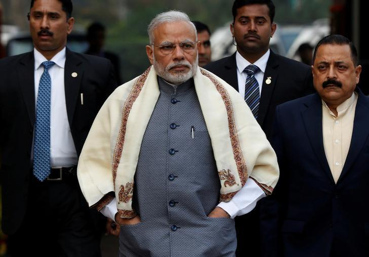 Prime Minister Narendra Modi walks to speak with the media as he arrives at the parliament house to attend the first day of the budget session, in New Delhi, India, January 31, 2017. REUTERS/Adnan Abidi/Files