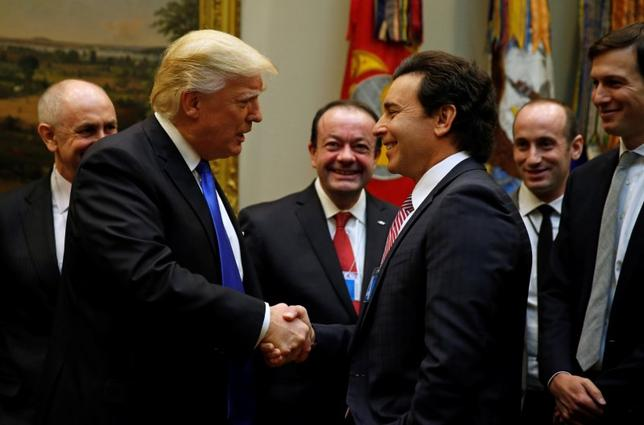 U.S. President Donald Trump greets Ford Motor Company CEO Mark Fields as he hosts a meeting with U.S. auto industry CEOs at the White House in Washington January 24, 2017.  REUTERS/Kevin Lamarque