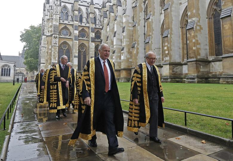 FILE PHOTO - President of the Supreme Court, David Neuberger (C), walks with fellow judges to Westminster Abbey for a service to mark the start of the legal year, London October 1, 2012. REUTERS/Luke MacGregor/File Photo
