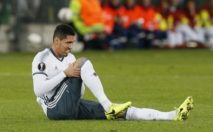 Soccer Football - Saint-Etienne v Manchester United - UEFA Europa League Round of 32 Second Leg - Stade Geoffroy-Guichard, Saint-Etienne, France - 22/2/17 Manchester United's Chris Smalling lies injured Reuters / Robert Pratta/ Livepic/ Files