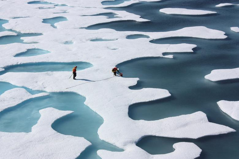 The crew of the  U.S. Coast Guard Cutter Healy, in the midst of their ICESCAPE mission, retrieves supplies for some mid-mission fixes dropped by parachute from a C-130 in the Arctic Ocean in this July 12, 2011 NASA handout photo obtained by Reuters June 11, 2012.  NASA/Kathryn Hansen/Handout via REUTERS/File Photo