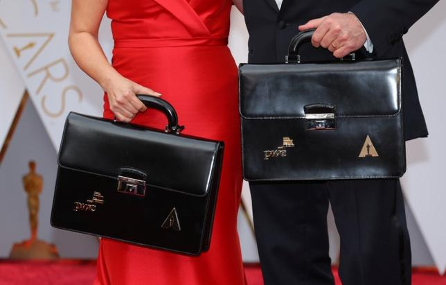 Oscar winning ballots are carried along the red carpet by personnel from Price Waterhouse Coopers as they arrive for the  89th Academy Awards in Hollywood, California, U.S. February 26, 2017. Picture taken February 26, 2017. REUTERS/Mike Blake
