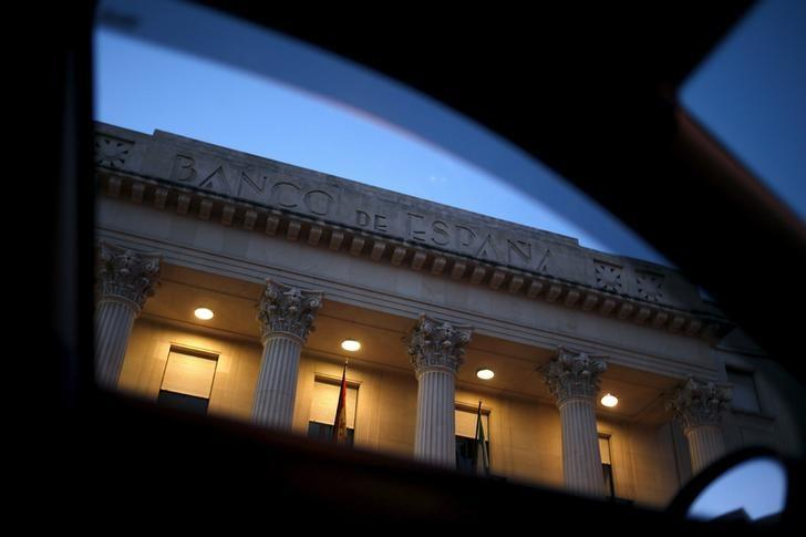 The facade of the Bank of Spain building is pictured through a window of a car in downtown Malaga, southern Spain, April 1, 2016. REUTERS/Jon Nazca