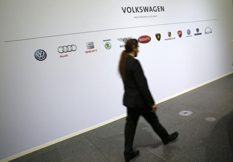 A man walks past the brands of the Volkswagen group during the annual news conference in Wolfsburg, Germany, April 28, 2016.    REUTERS/Fabrizio Bensch