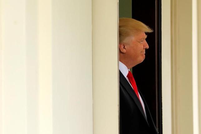 3月30日、米司法省は、イスラム圏諸国からの入国を制限する新たな大統領令の差し止めを命じたハワイ州連邦地裁の判断に対し、控訴する方針だ。写真はトランプ大統領、ワシントンで30日撮影(2017年 ロイター/Jonathan Ernst)