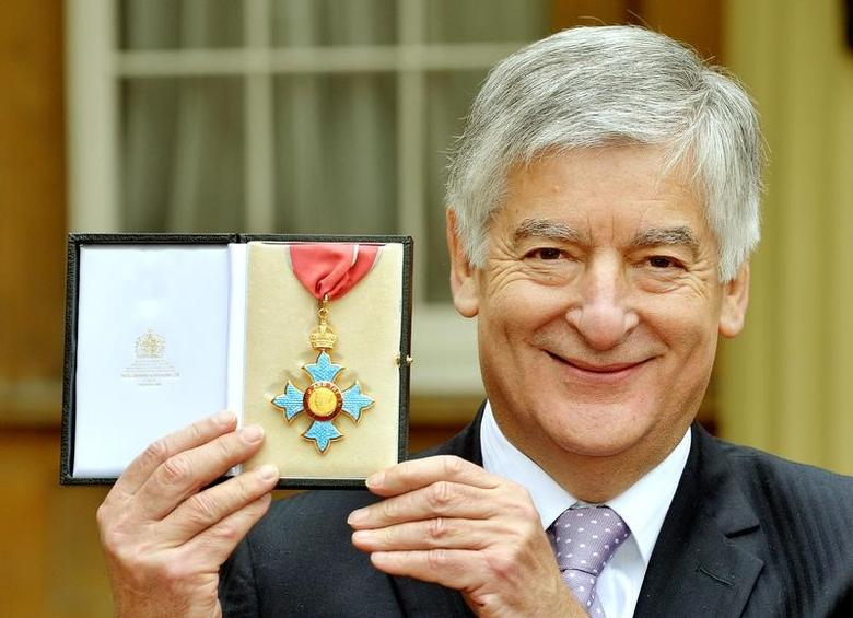 Former Football Association chairman David Bernstein poses with his Commander of the Order of the British Empire (CBE) medal after being knighted by Britain's Prince Charles at Buckingham Palace in London February 12, 2014. REUTERS/John Stillwell/pool/Files