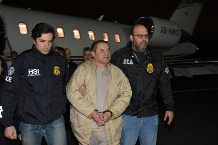 Mexico's top drug lord Joaquin ''El Chapo'' Guzman is escorted as he arrives at Long Island MacArthur airport in New York, U.S., January 19, 2017, after his extradition from Mexico.  U.S. officials/Handout via REUTERS/Files