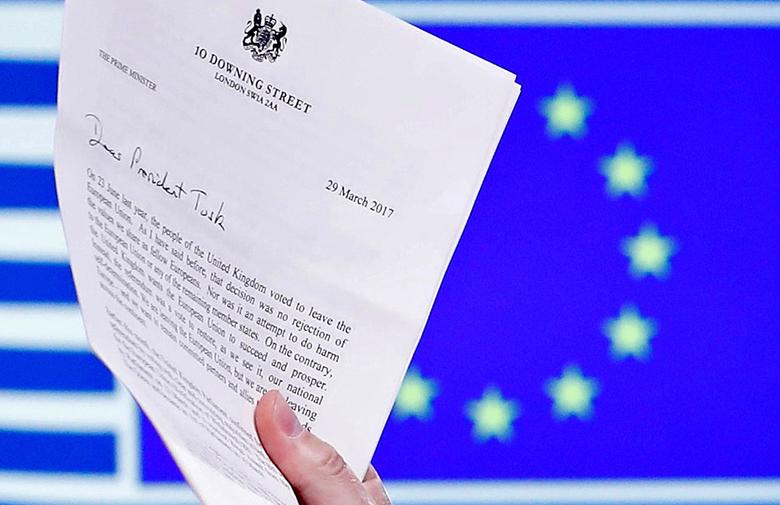 EU Council President Donald Tusk holds British Prime Minister Theresa May's Brexit letter, which was delivered by Britain's permanent representative to the European Union Tim Barrow (not pictured) that gives notice of the UK's intention to leave the bloc under Article 50 of the EU's Lisbon Treaty, in Brussels, Belgium, March 29, 2017.  REUTERS/Yves Herman