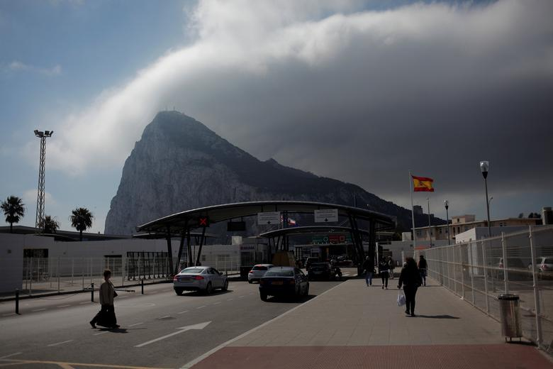 People enter the British territory of Gibraltar, historically claimed by Spain, at its border with Spain, in La Linea de la Concepcion, Spain March 29, 2017. REUTERS/Jon Nazca