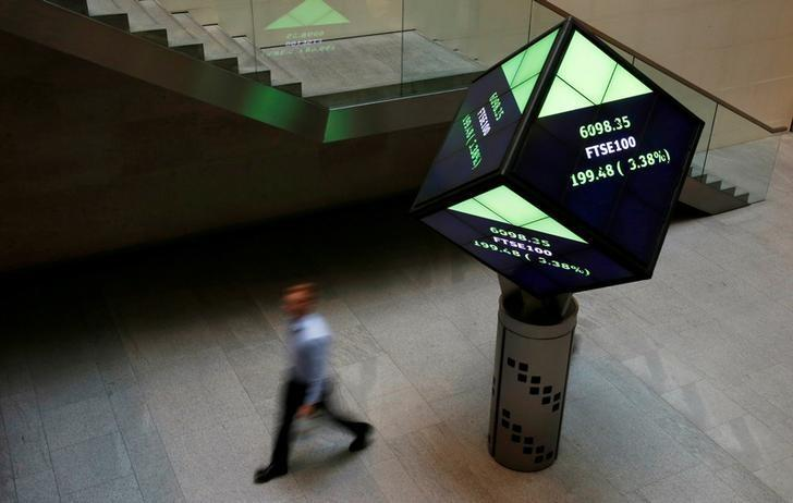 FILE PHOTO:  A man walks through the lobby of the London Stock Exchange in London, Britain, August 25, 2015.      REUTERS/Suzanne Plunkett/File Photo/File Photo