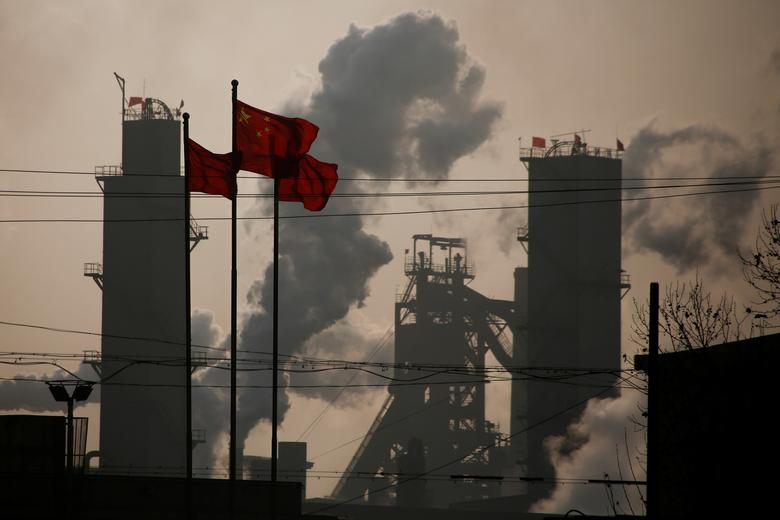 Chinese national flags are flying near a steel factory in Wu'an, Hebei province, China, February 23, 2017. Picture taken February 23, 2017.  REUTERS/Thomas Peter