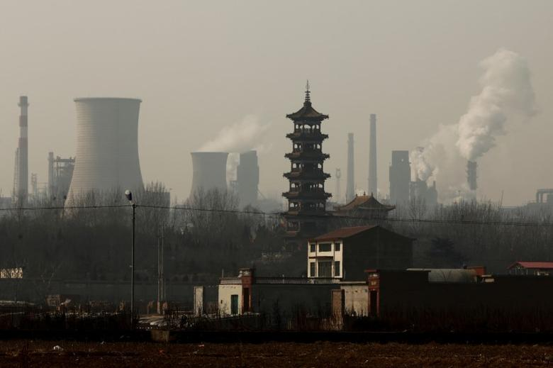 Cooling towers emit steam and chimneys billow in an industrial zone in Wu'an, Hebei province, China, February 23, 2017. REUTERS/Thomas Peter