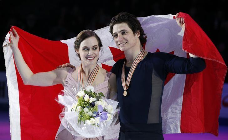 Figure Skating - ISU World Championships 2017 - Ice Dance Victory Ceremony - Helsinki, Finland - 1/4/17 - Gold medallists Tessa Virtue and Scott Moir of Canada attend the ceremony. REUTERS/Grigory Dukor