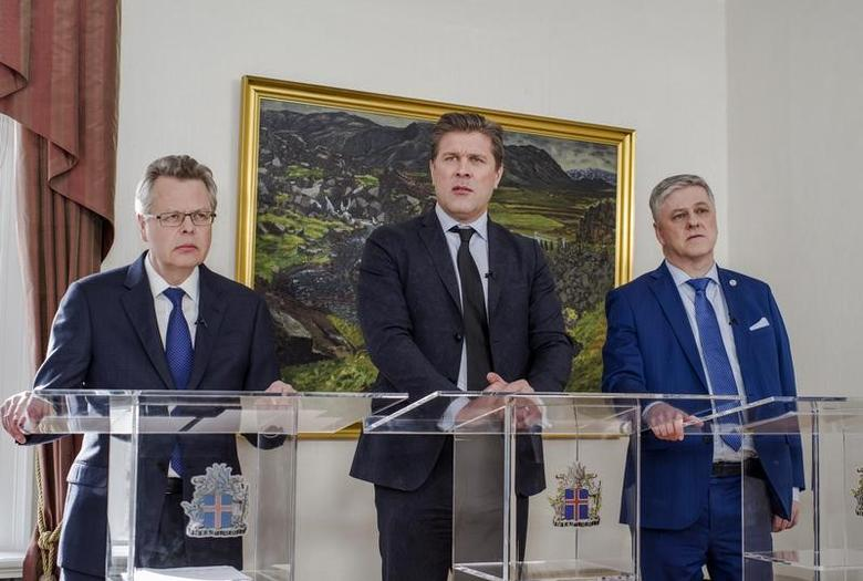 Iceland's Central Bank governor Mar Gudmundsson (L to R), Prime Minister Bjarni Benediktsson, Finance minister Benedikt Johannesson attend a news conference in Reykjavik, Iceland, March 12, 2017. REUTERS/Geirix