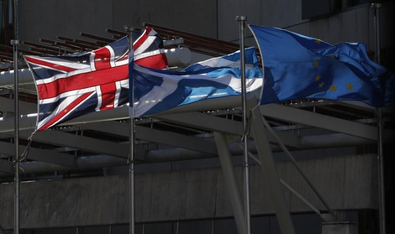 FILE PHOTO: The Union flag,The Scottish Saltire and The European flag fly at the Scottish Parliament in Edinburgh Scotland, Britain March 21, 2017. REUTERS/Russell Cheyne