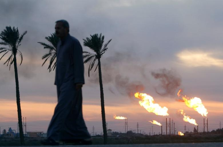 FILE PHOTO:  Flames emerge from flare stacks at the oil fields in Basra, Iraq, January 17, 2017. REUTERS/Essam Al-Sudani/File Photo